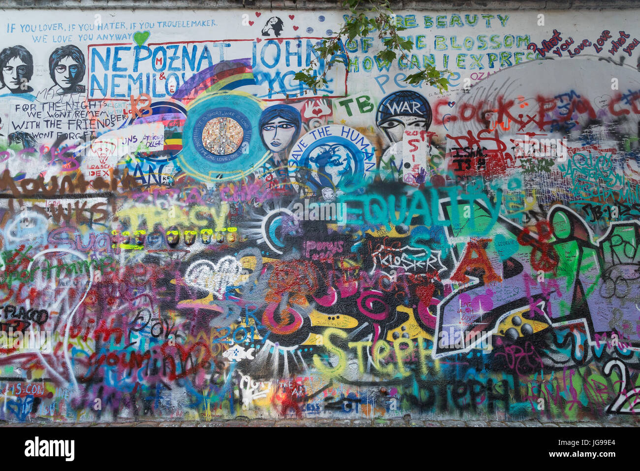 John lennon wall in prague czech republic its a wall with pieces of lyrics from beatles songs and john lennon inspired graffiti and art