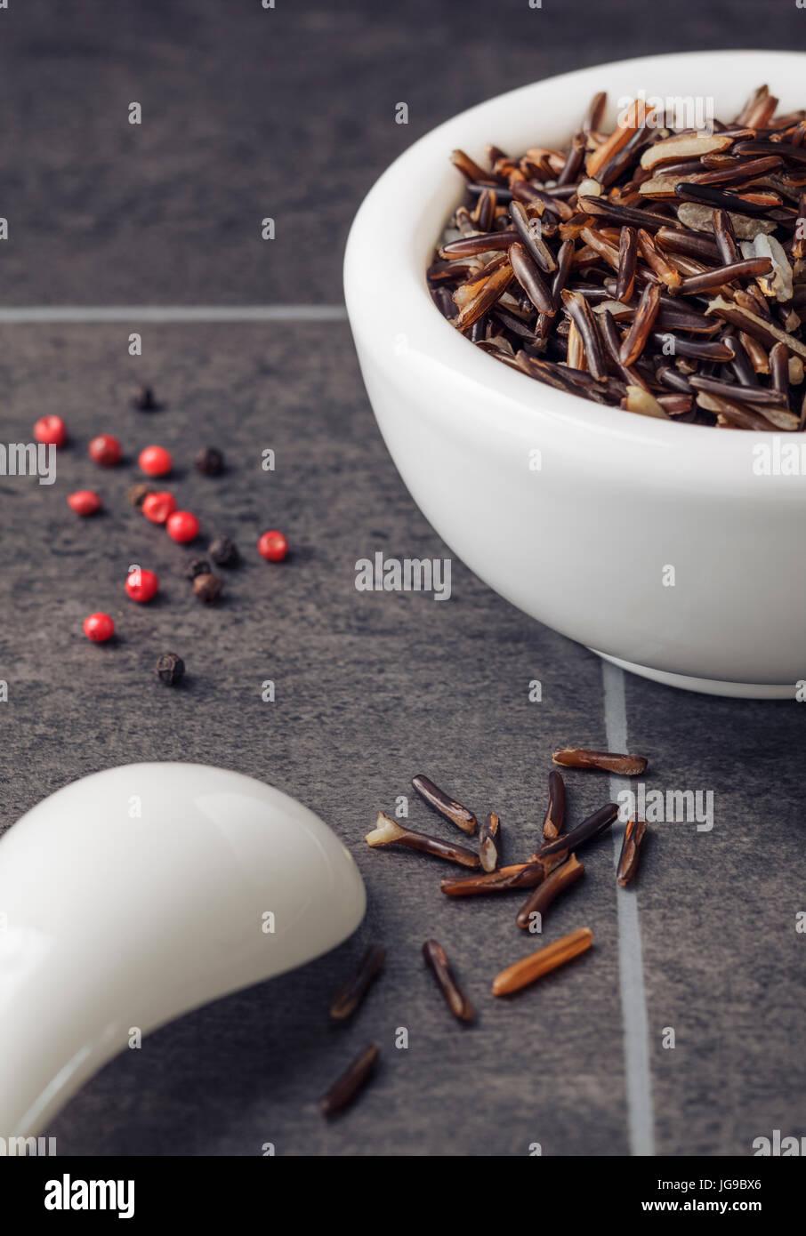 Wild Rice in white bowl - Stock Image