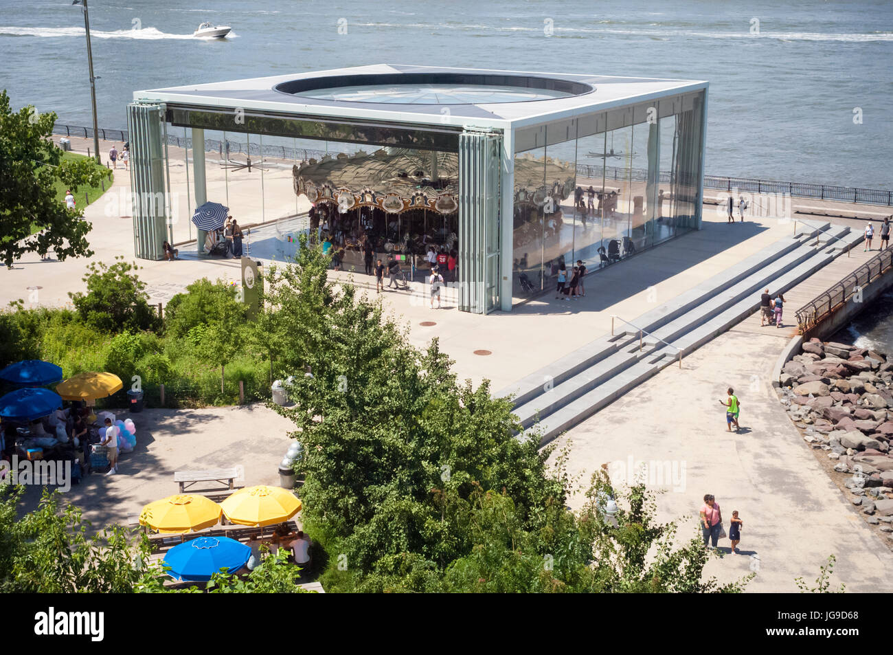 Visitors to Brooklyn Bridge Park enjoy Jane's Carousel on Sunday, July 2, 2017.  The historic carousel was originally - Stock Image