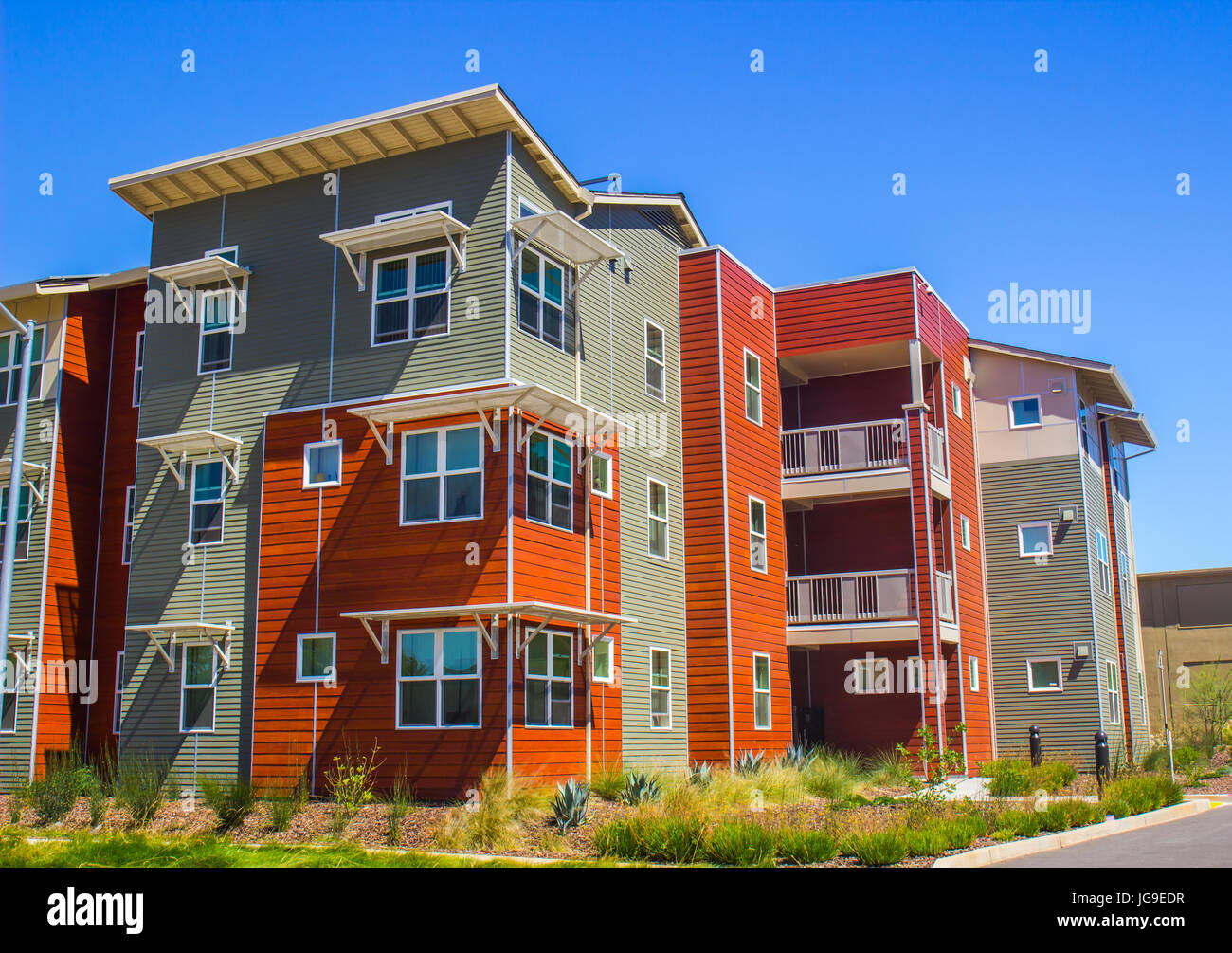 Multi Colored Three Story Living Quarters - Stock Image