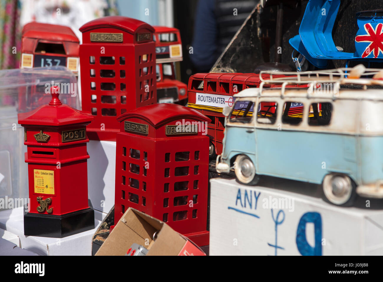 LONDON, ENGLAND - JULY 12, 2017 Many collectable old toy vehicles in bright colors on display in a window shop. Stock Photo