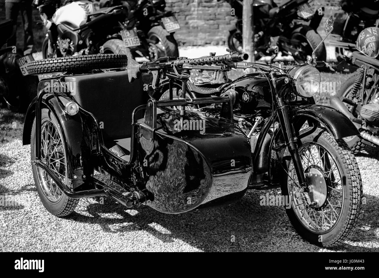 Beautiful, old, personalized military motorcycle BMW R71 after renovation on a motorcycles meeting. Black and white. - Stock Image