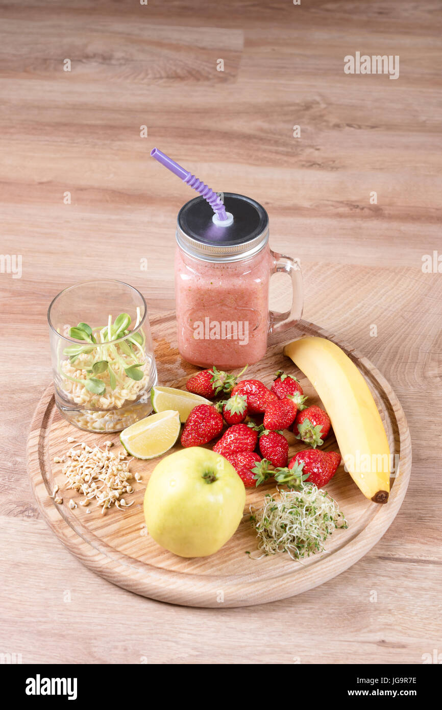 Detox cleanse drink, fruits and berries smoothie ingredients. Natural, organic healthy juice for weight loss diet - Stock Image