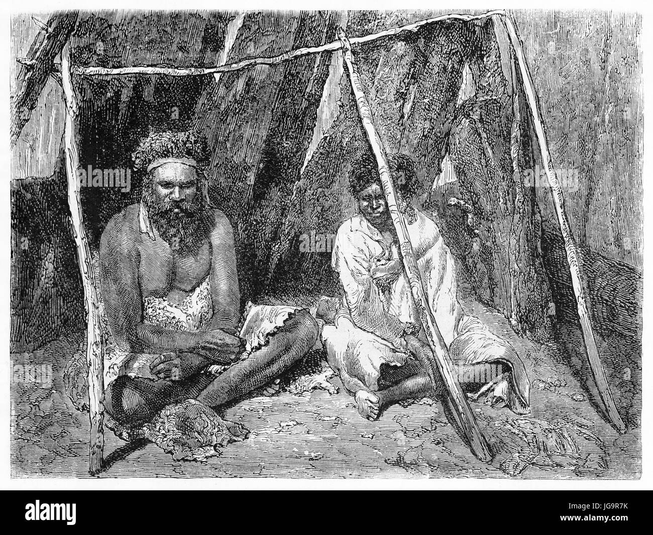 Old illustrationof Australian aboriginals under makeshift shelter. Created by Riou after photo of unknown author, - Stock Image
