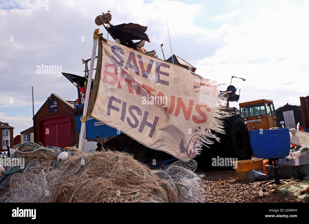 Aldeburgh Suffolk UK June 2017 - Tatty Save Britains Fish flags on fishing boats on Aldeburgh beach Photograph taken - Stock Image