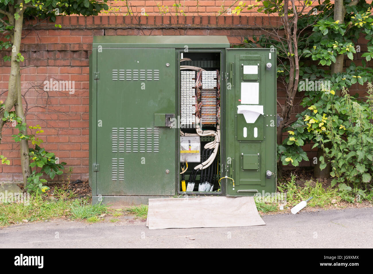 open bt openreach green cabinet primary cross connection point, England, UK - Stock Image
