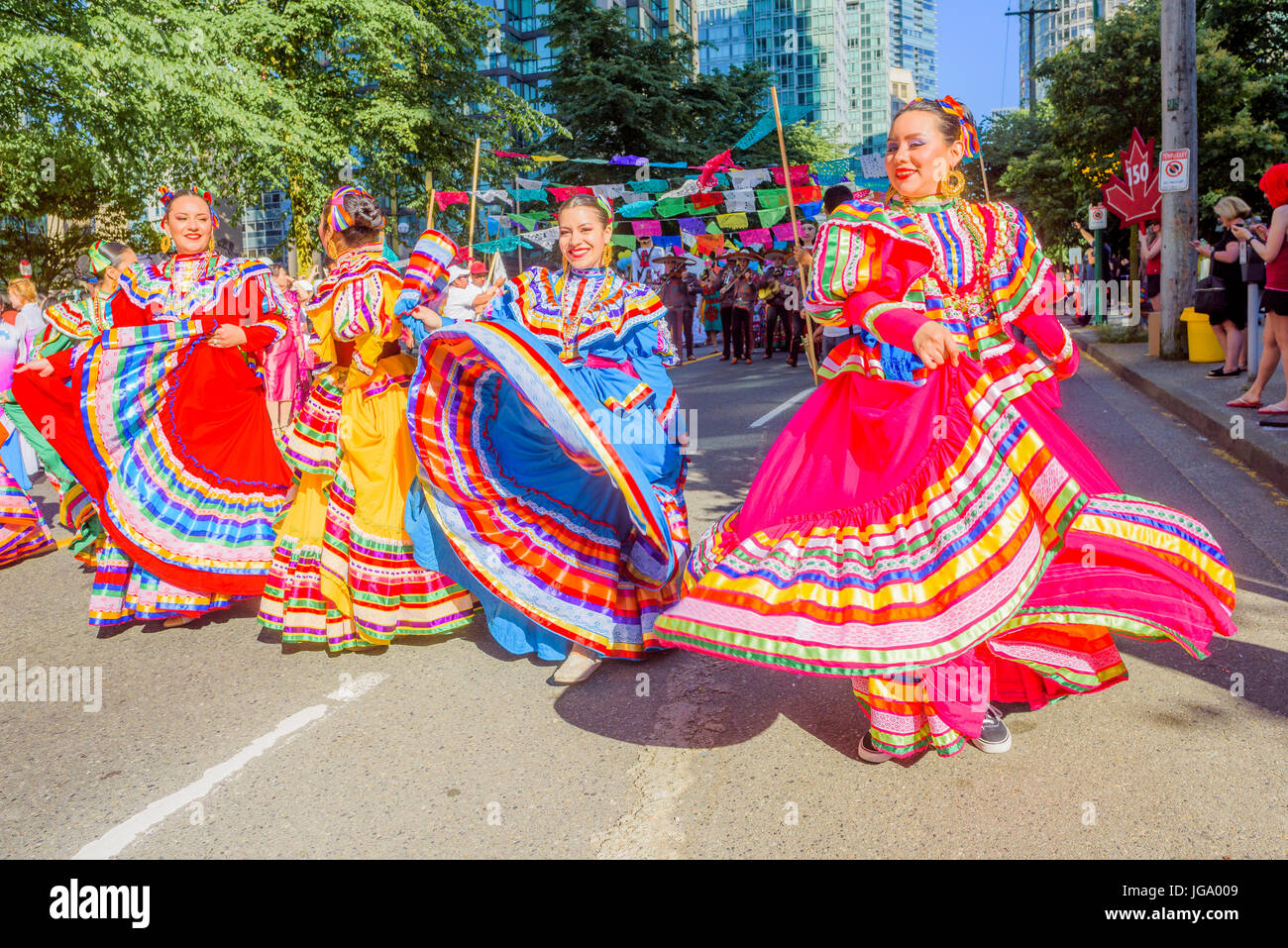 Mexican Group celebrates being Canadian at Canada 150, Canada Day Parade, Vancouver, British Columbia, Canada. - Stock Image