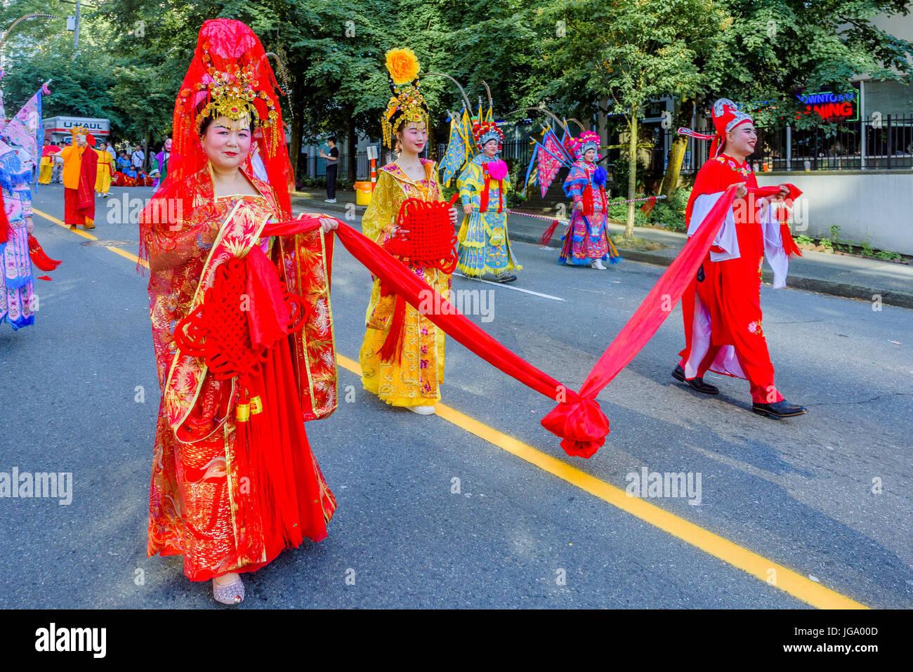 Chinese Opera celebrates at Canada 150, Canada Day Parade, Vancouver, British Columbia, Canada. - Stock Image