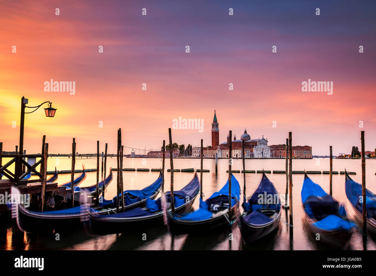 Dawn over the Grand Canal in Venice, Italy.  The island of San Giorgio is in the background - Stock Image
