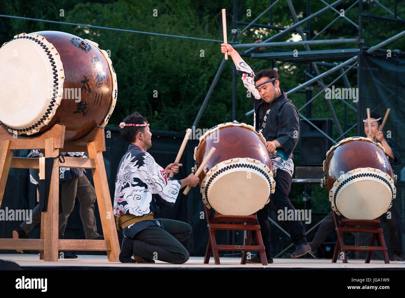 Japanese drum virtuosos during the show at Matsumoto Drum festival. Matsumoto Taiko Matsuri. Japan - Stock Image