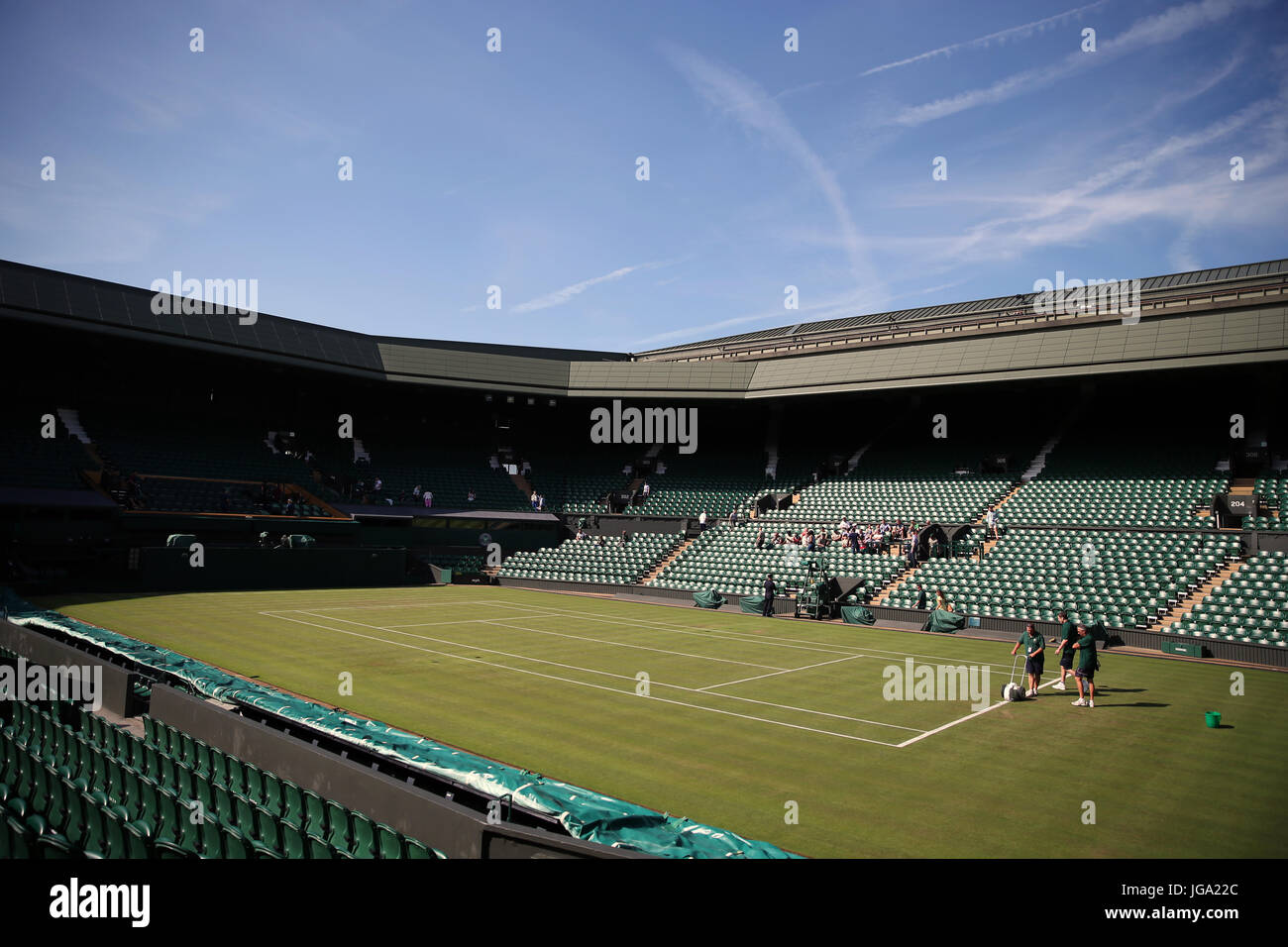 new styles 98eb6 fce4c Ground staff prepare centre court on day three of the Wimbledon  Championships at The All England Lawn Tennis and Croquet Club, Wimbledon.