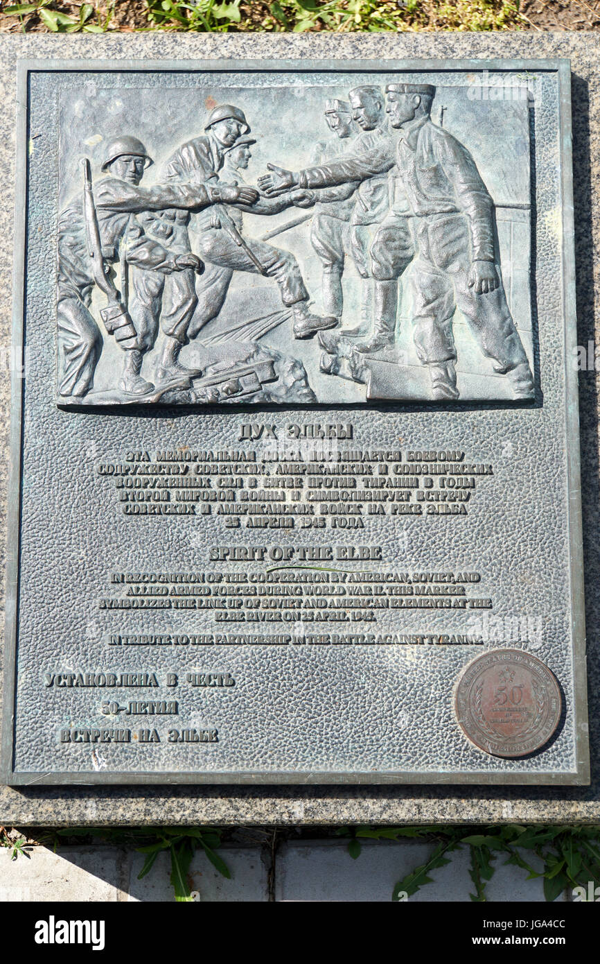 A plaque commemorating the meeting of Soviet and American soldiers at the river Elbe near Torgau in Germany, in Stock Photo