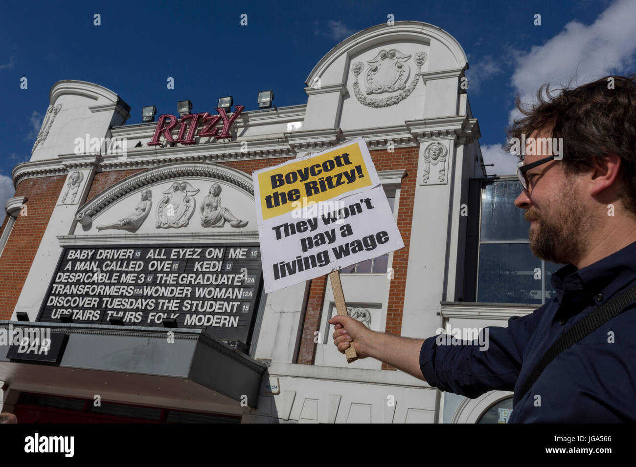 A placard is held up to the frontage of the Ritzy Cinema, part of the Picturehouse chain, in dispute with Bectu - Stock Image