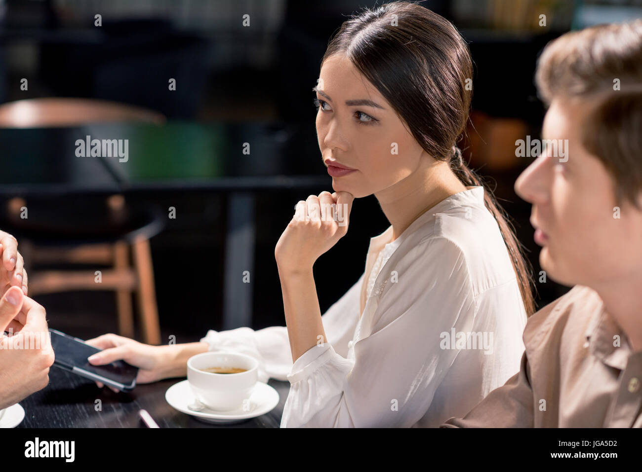 business team on meeting discussing project in cafe, business lunch concept - Stock Image