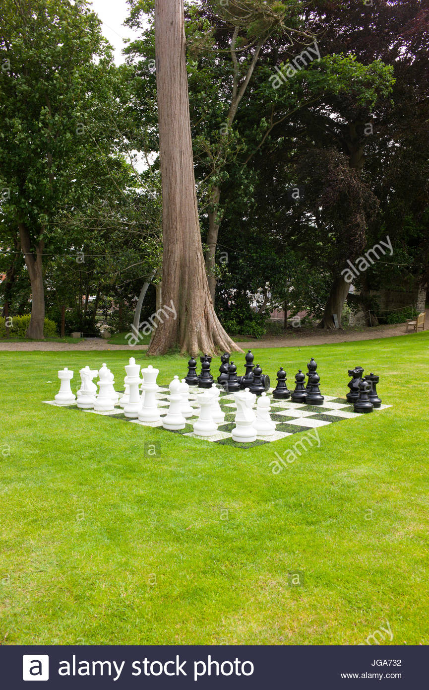 Giant chess board and pieces on the lawn of Castle Green House, Cardigan Castle, Ceredigion, Wales, UK - Stock Image