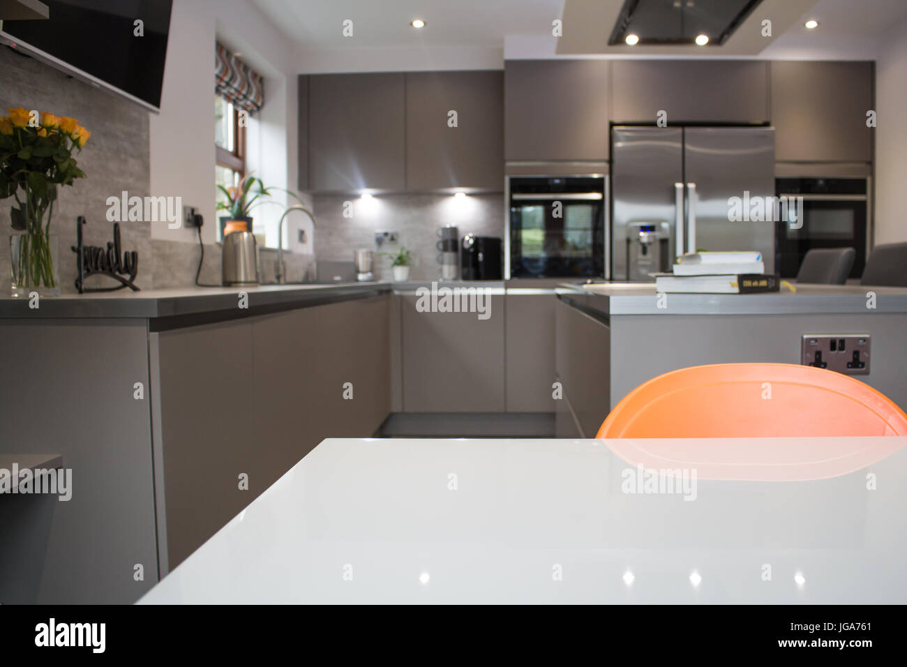 A Modern Luxury Matt Grey Kitchen Interior Showing A Centre Island