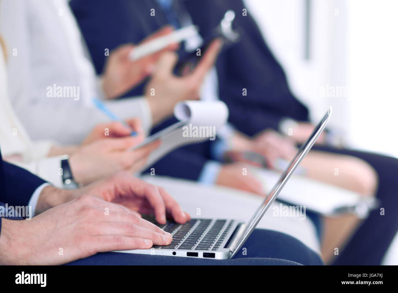 Close-up of business man hands typing on laptop computer at the conference - Stock Image