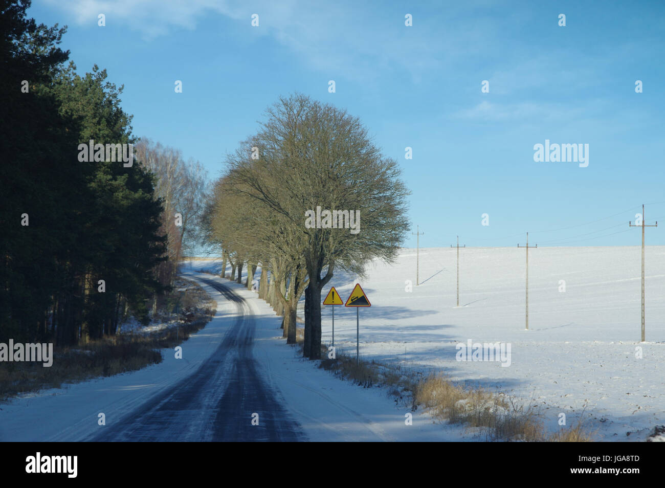 Snow and rime road up in winter - Stock Image