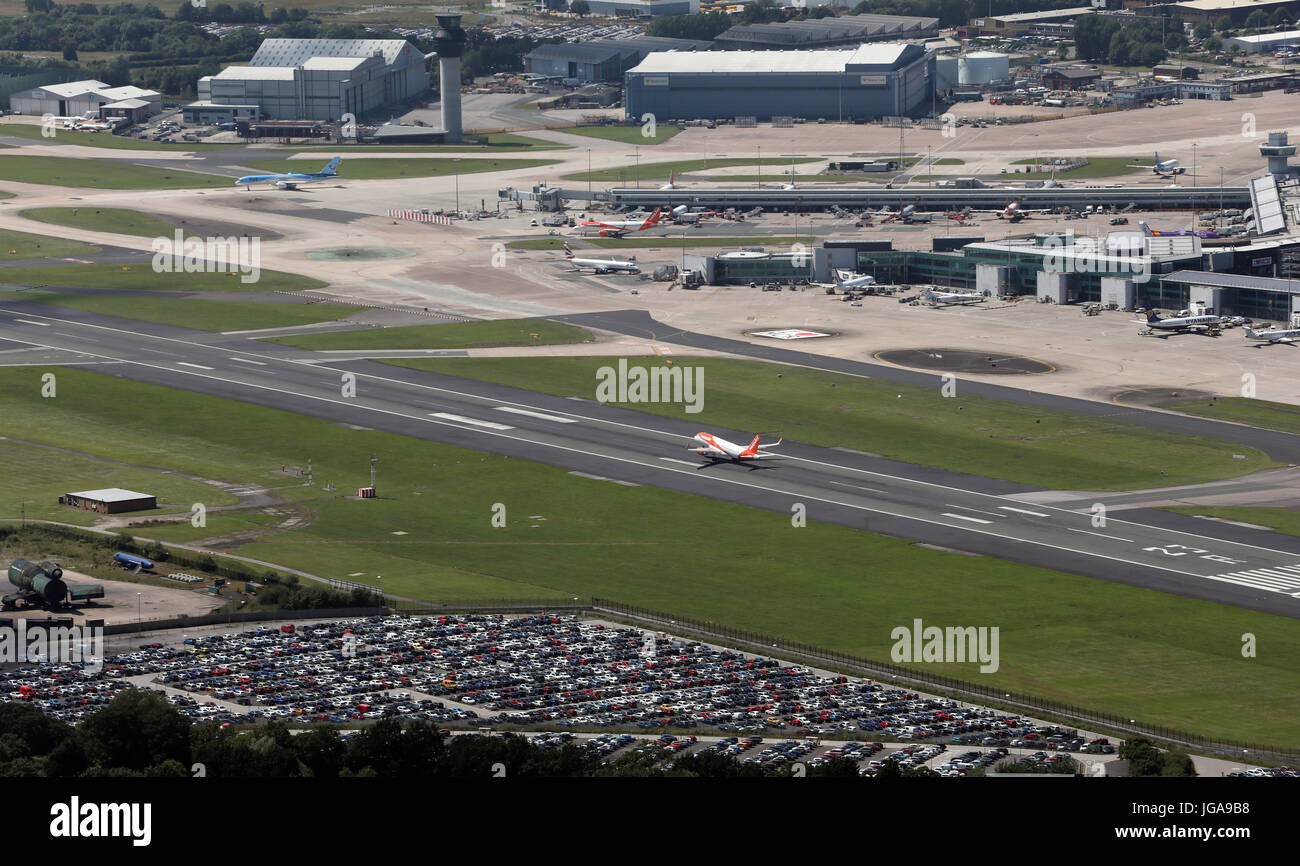 aerial view of an EastJet aircraft landing at Manchester Airport, UK - Stock Image