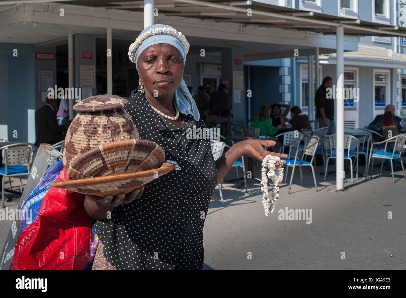 basket seller,Maun Botswana,airport - Stock Image