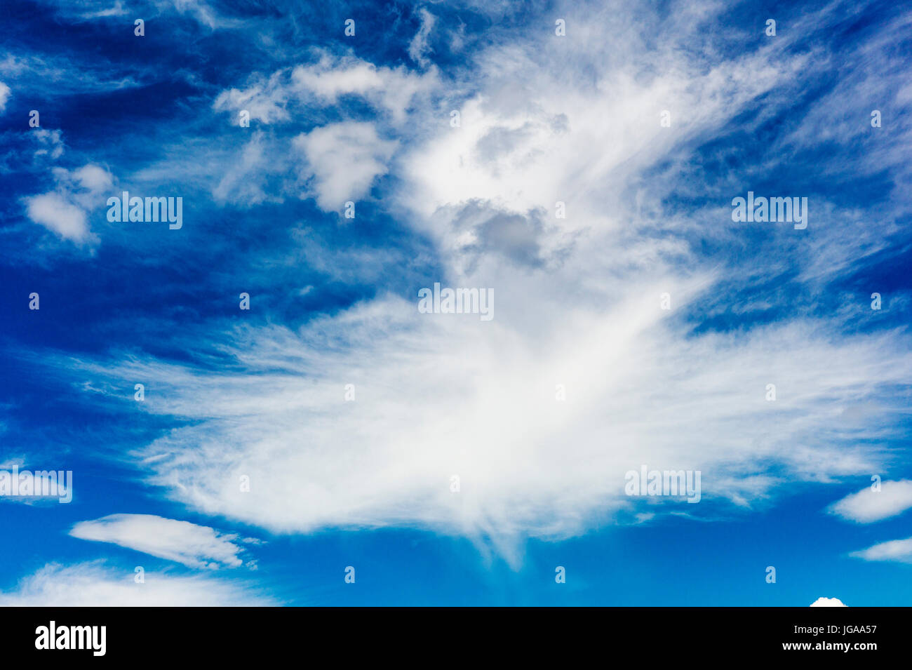 Fair weather high clouds against clear blue Colorado sky - Stock Image