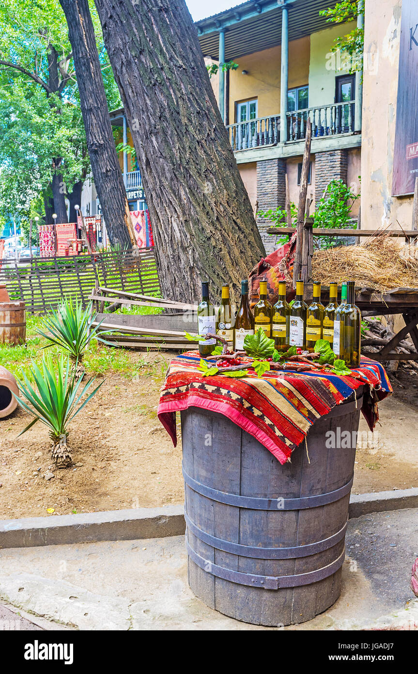 TBILISI, GEORGIA - JUNE 6, 2016: The barrel with wine bottles is the best commercial for traditional Georgian restaurant, Stock Photo