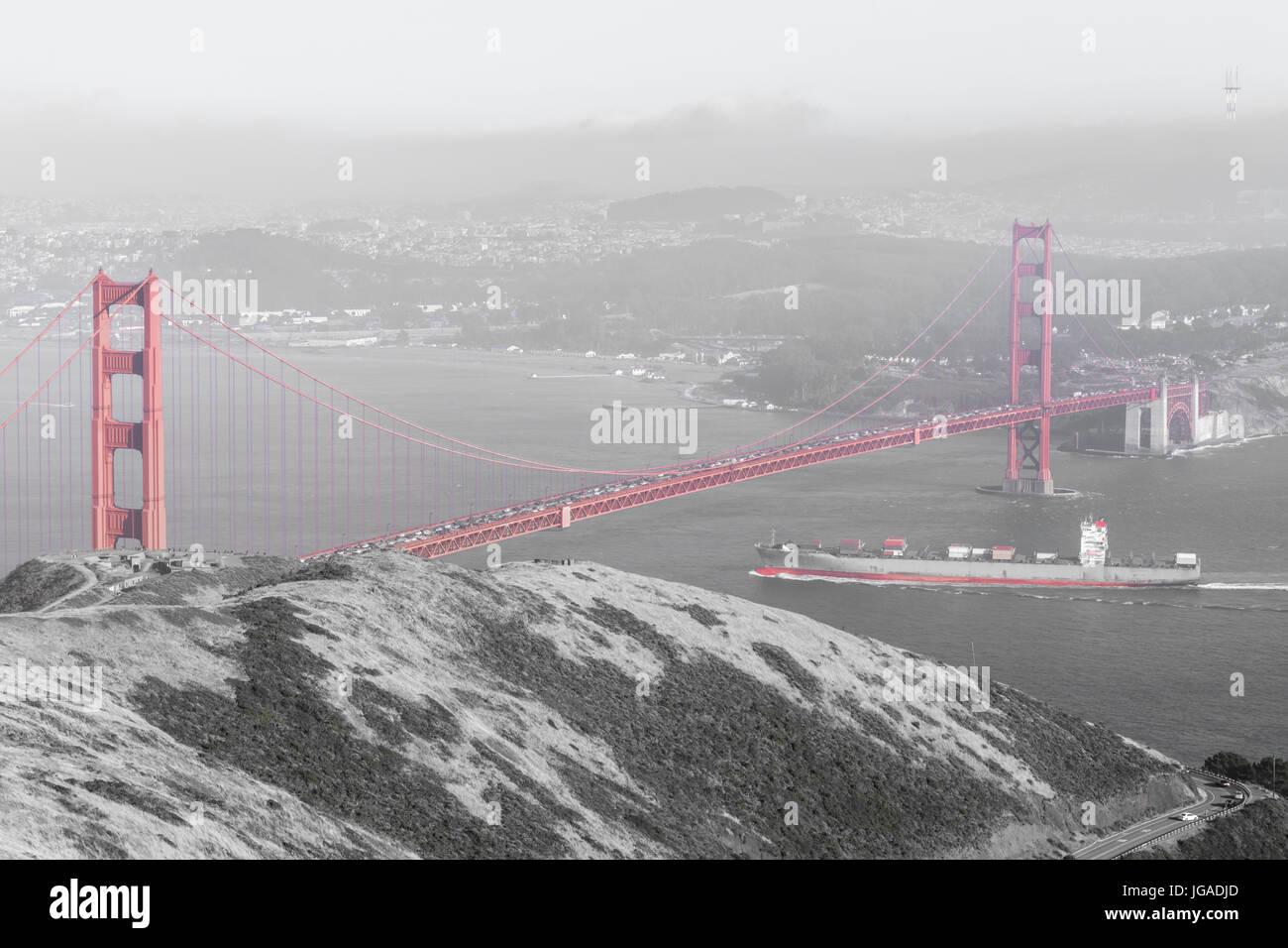 Cargo ship crossing the Golden Gate Bridge. - Stock Image