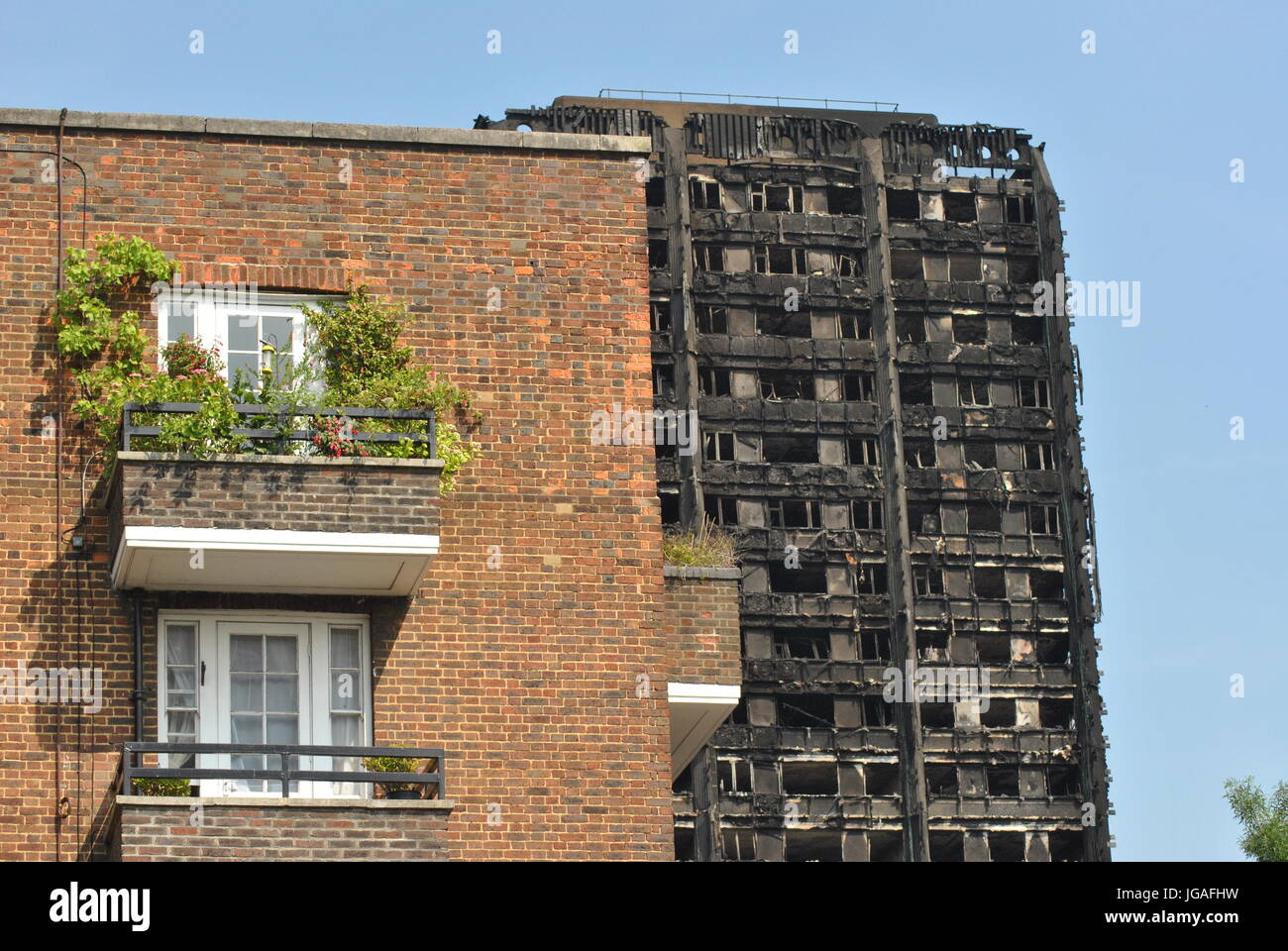 Grenfell Tower Disaster, Skeletal Remains of Tower, juxtaposed with private property, Latimer Road, London 19th - Stock Image