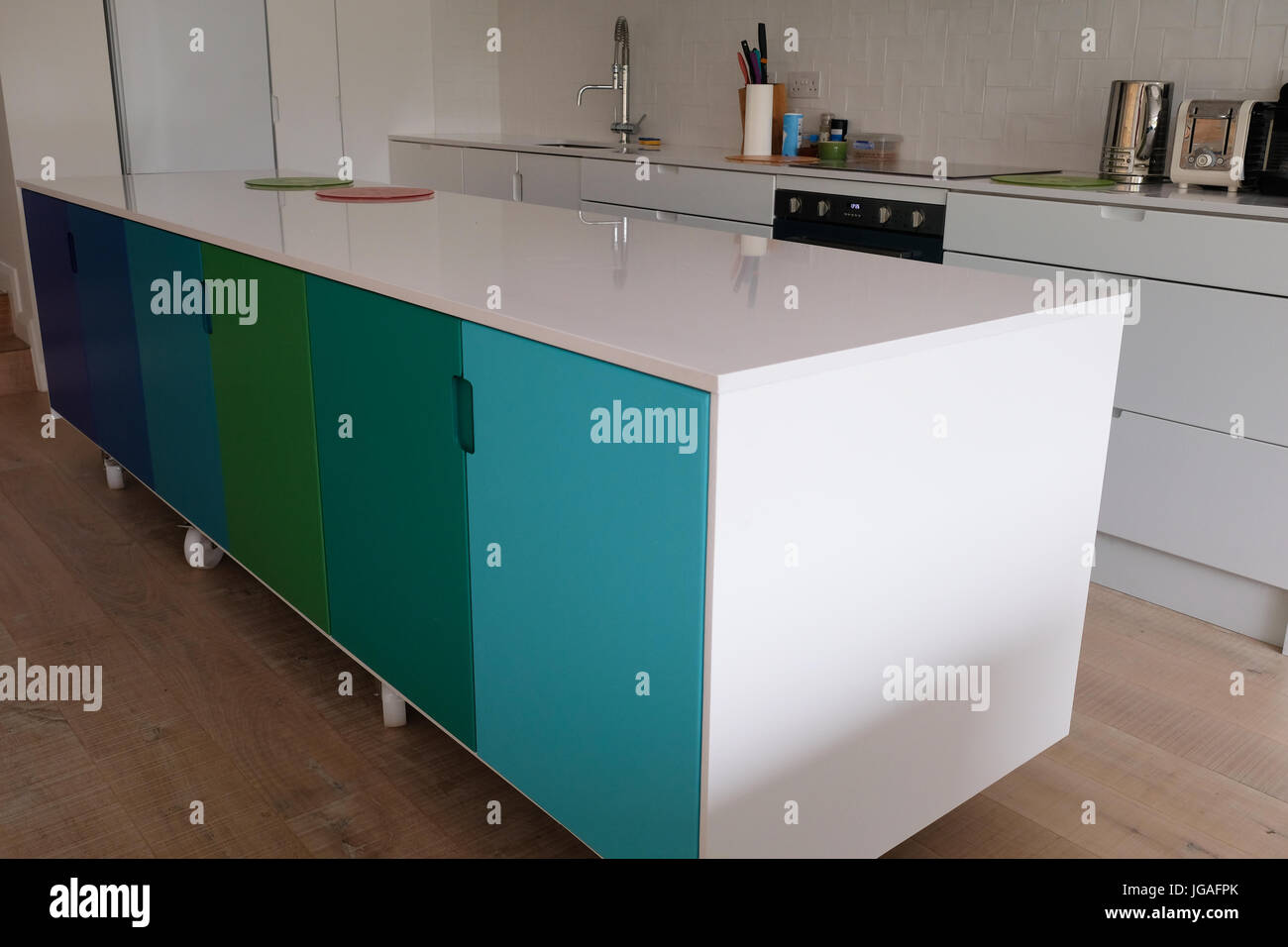 Ombre Painted Kitchen Cupboards Stock Photos & Ombre Painted Kitchen ...