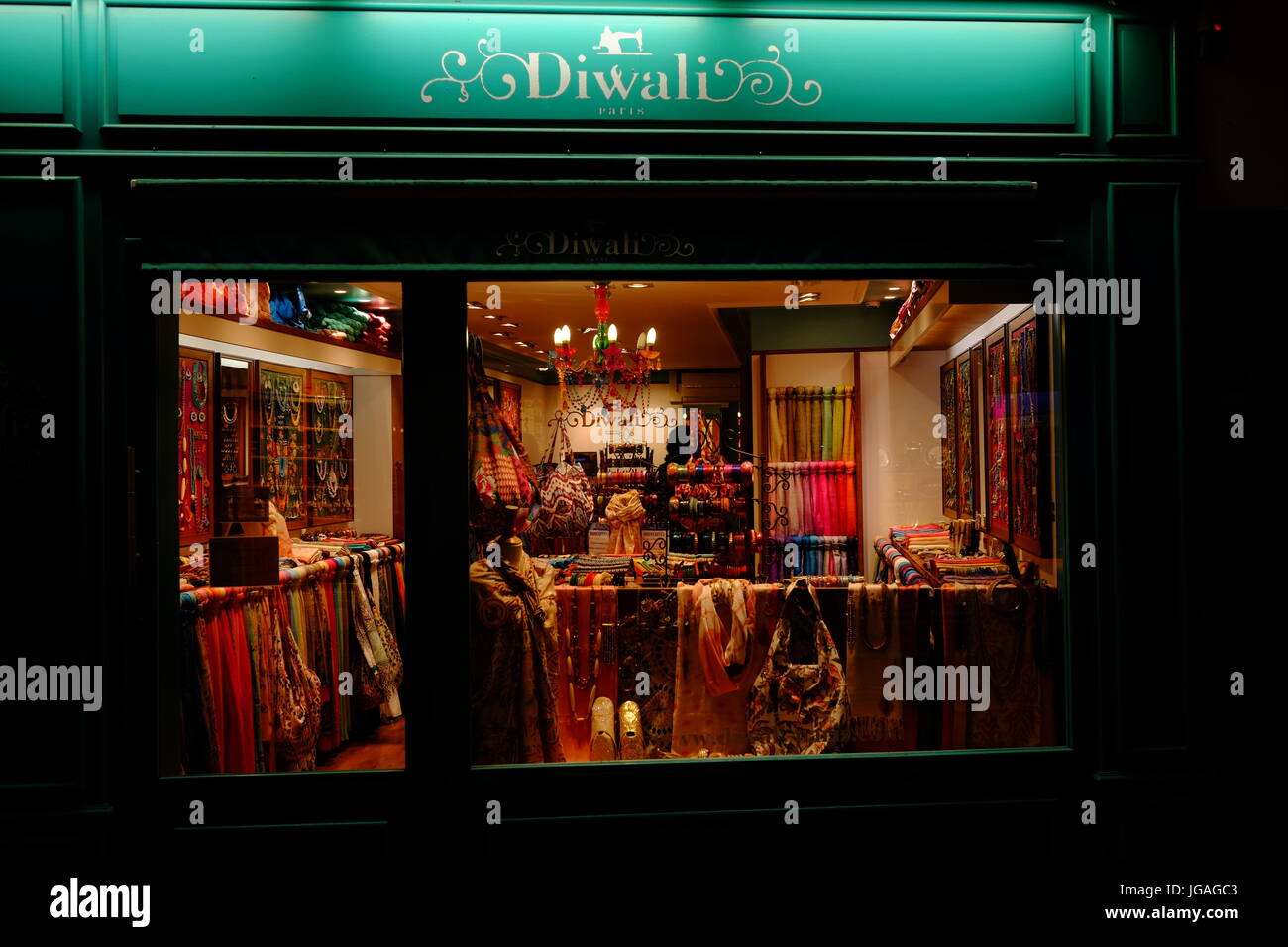 Shopfront at night in Montmartre, Paris, France - Stock Image