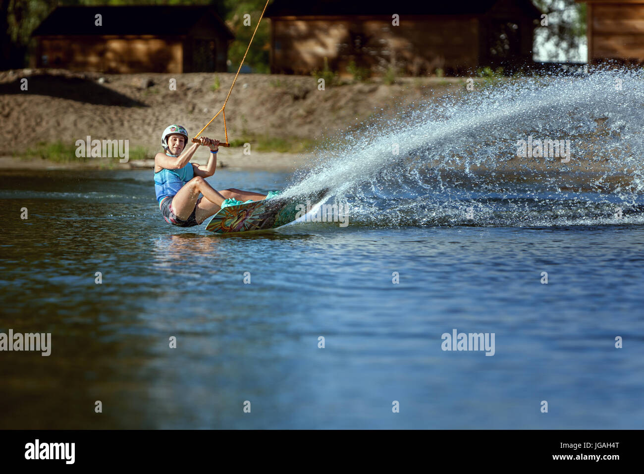Waking on wakeboarding summer sport, a woman trains. - Stock Image