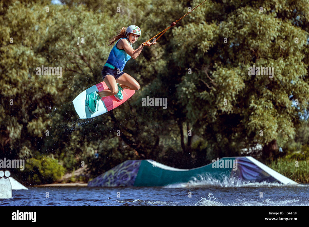 World champion in wakeboarding, she trains to jump. - Stock Image