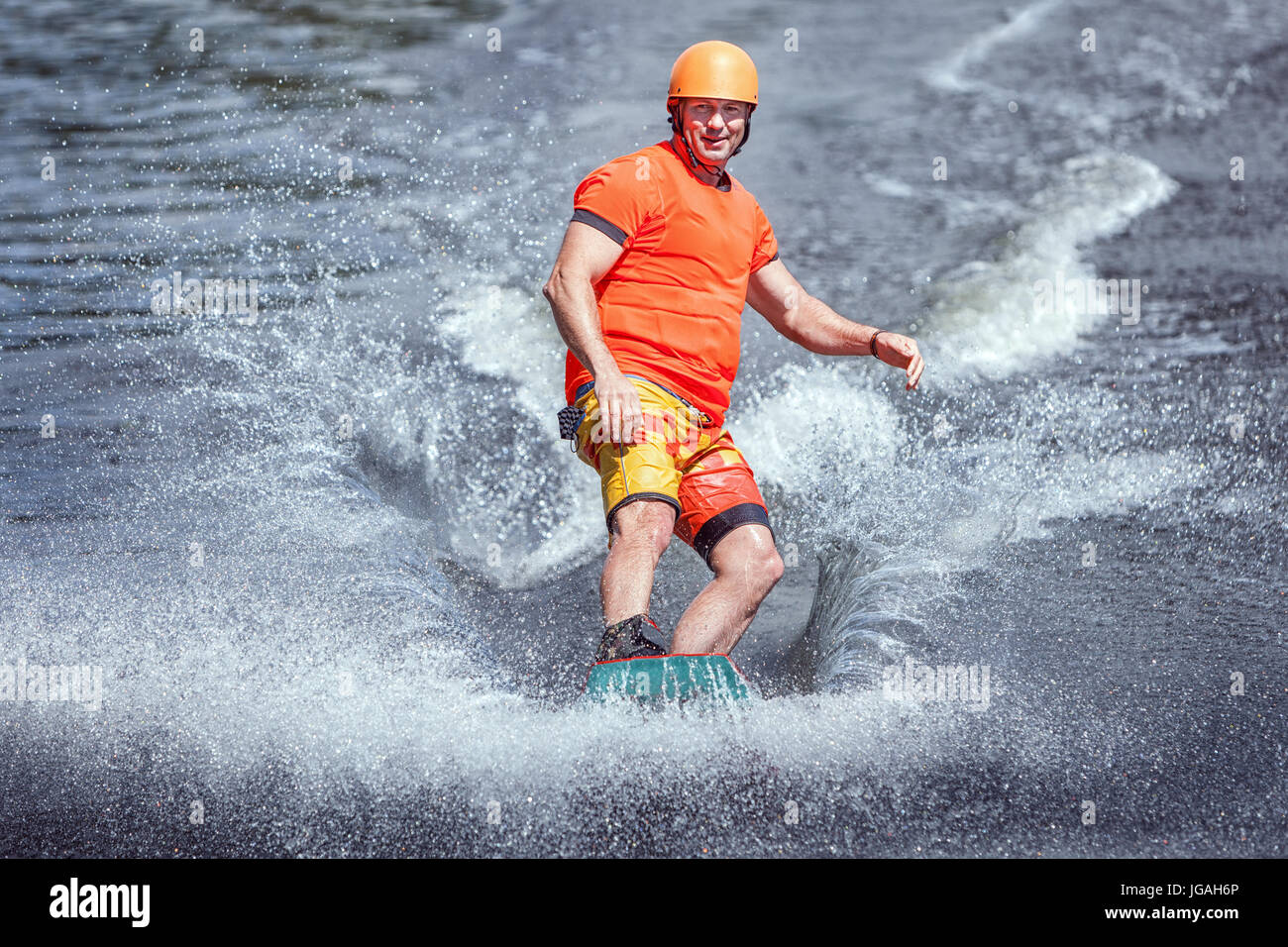Surfing the waves on the wakeboard. Extreme sports. - Stock Image