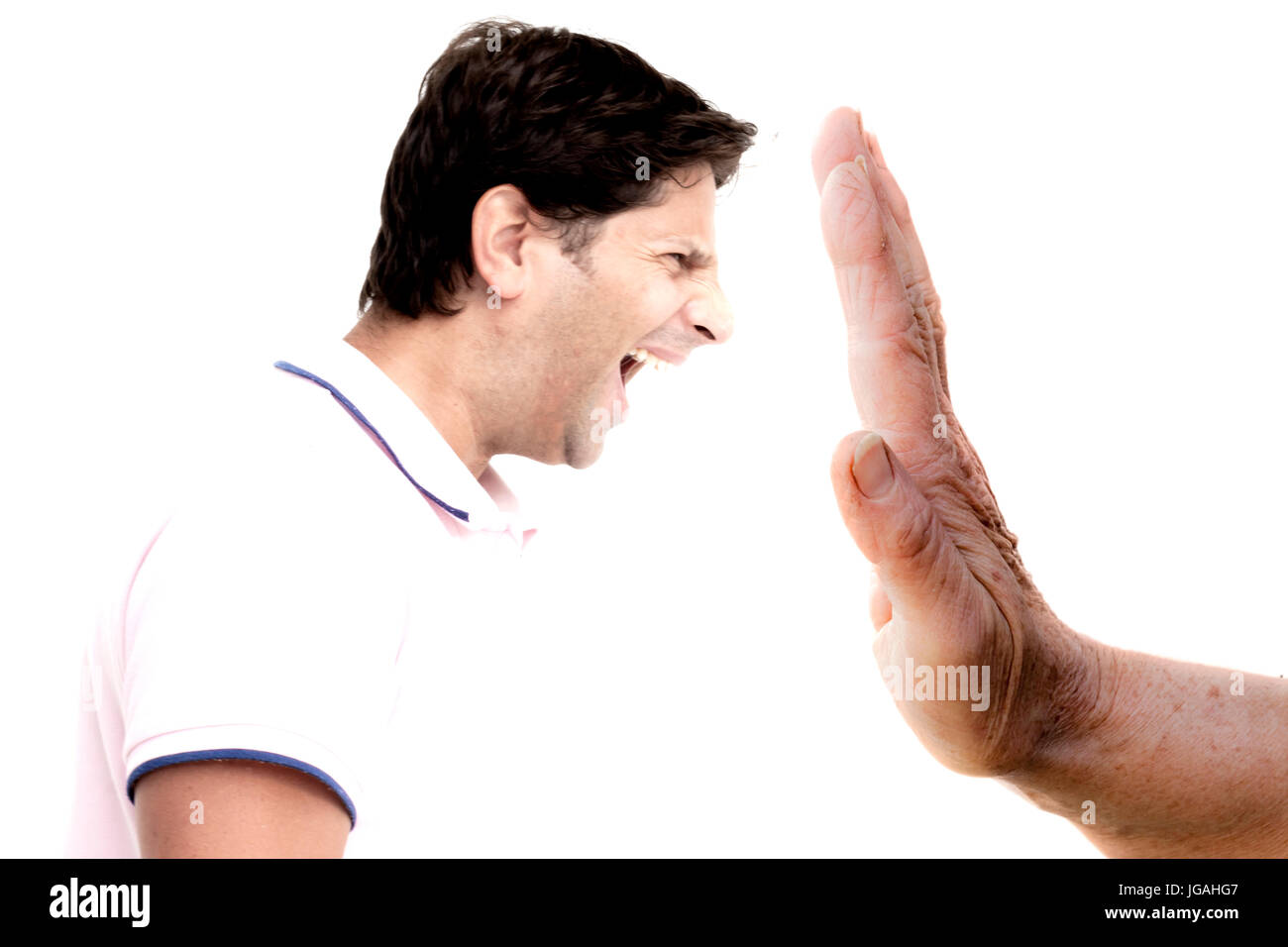 Hand of a woman stopping man's shoutings - Stock Image