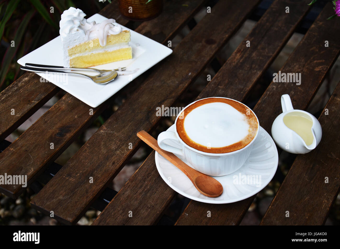 Latte Hot Coffee And Coconut Cake On Table In Garden Of Coffee Shop Stock Photo Alamy