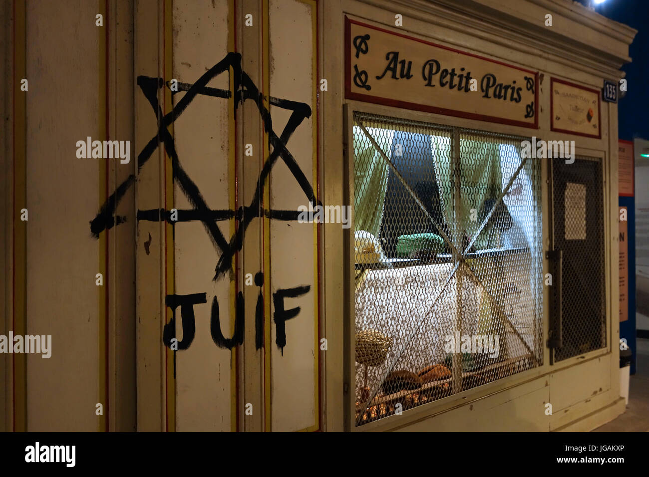 Star of David painted on shop front by Nazis during Holocaust to identify Jews at the Memorial World War II Museum - Stock Image