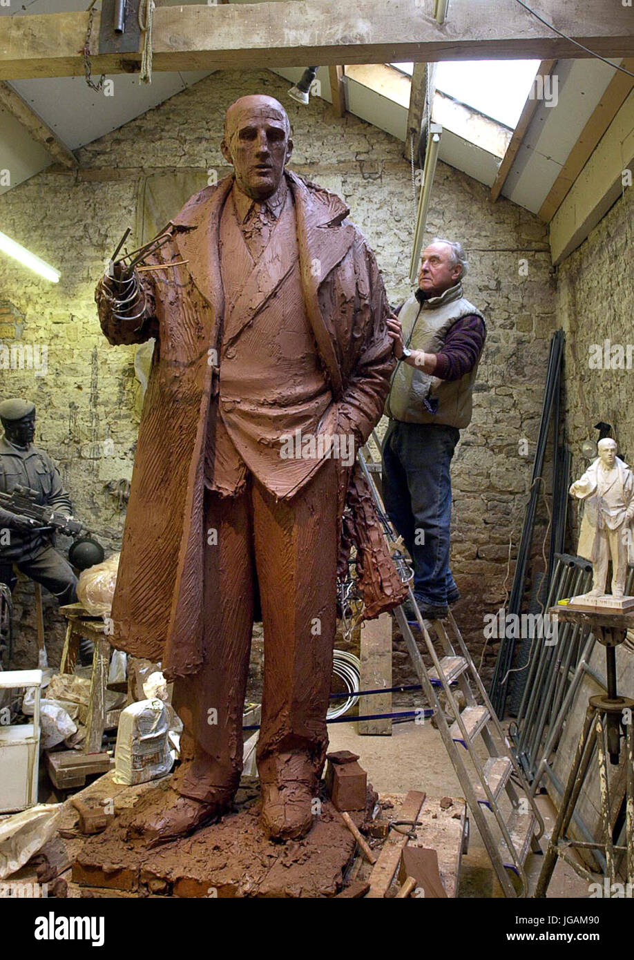 Sculptor James Butler working on the clay statue of former Wolves manager and player Stan Cullis. - Stock Image