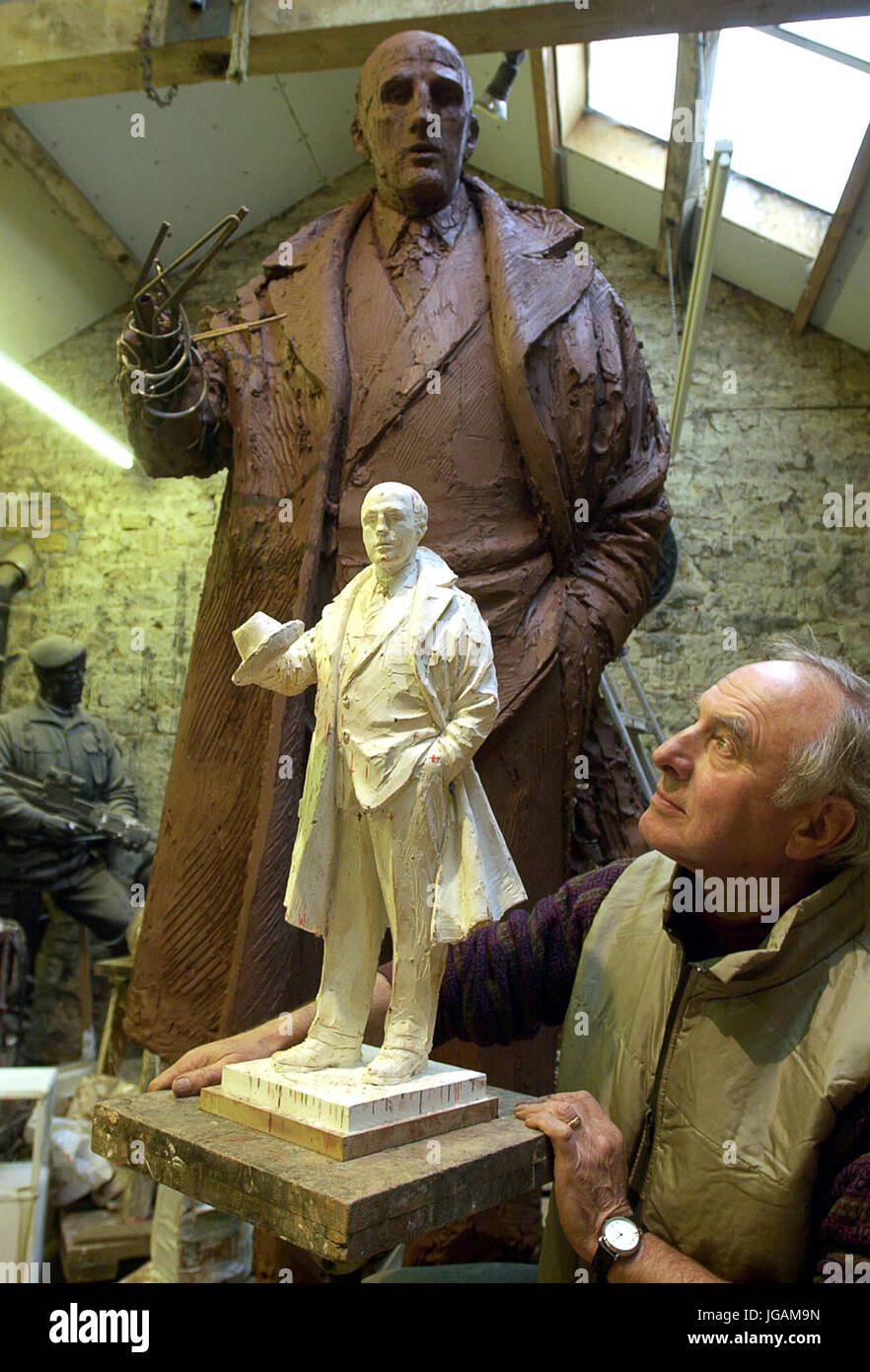 Sculptor James Butler with the small clay statue of former Wolves manager and player Stan Cullis with the full size - Stock Image