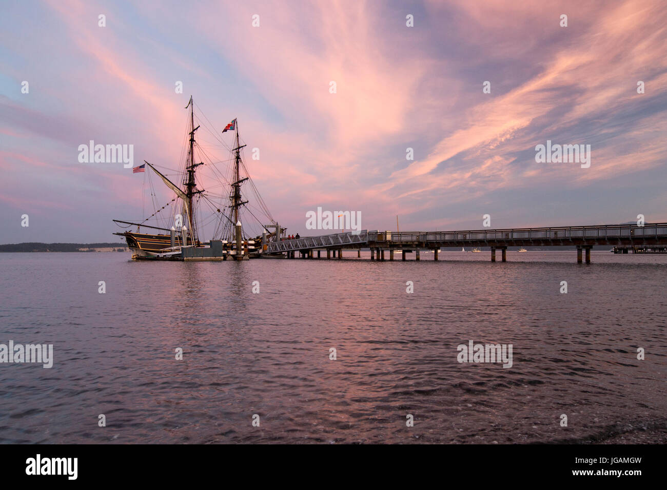 Port Townsend sunset with wooden sailing boat Lady Washington. - Stock Image