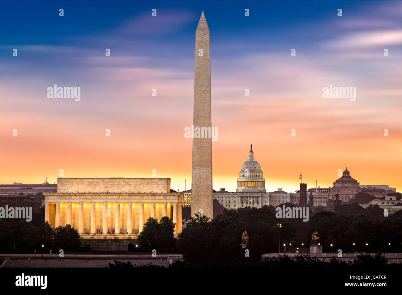 New Dawn over Washington - with 3 iconic monuments illuminated at sunrise: Lincoln Memorial, Washington Monument - Stock Image