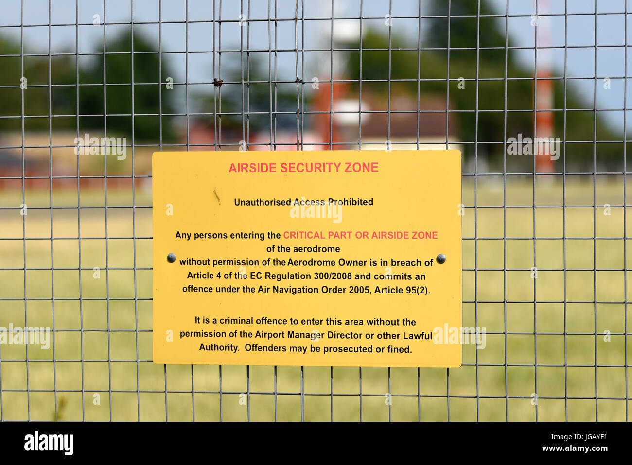 Airside security zone sign on the perimeter fence at London Southend Airport Essex. Quoting article 4 ec regulation - Stock Image