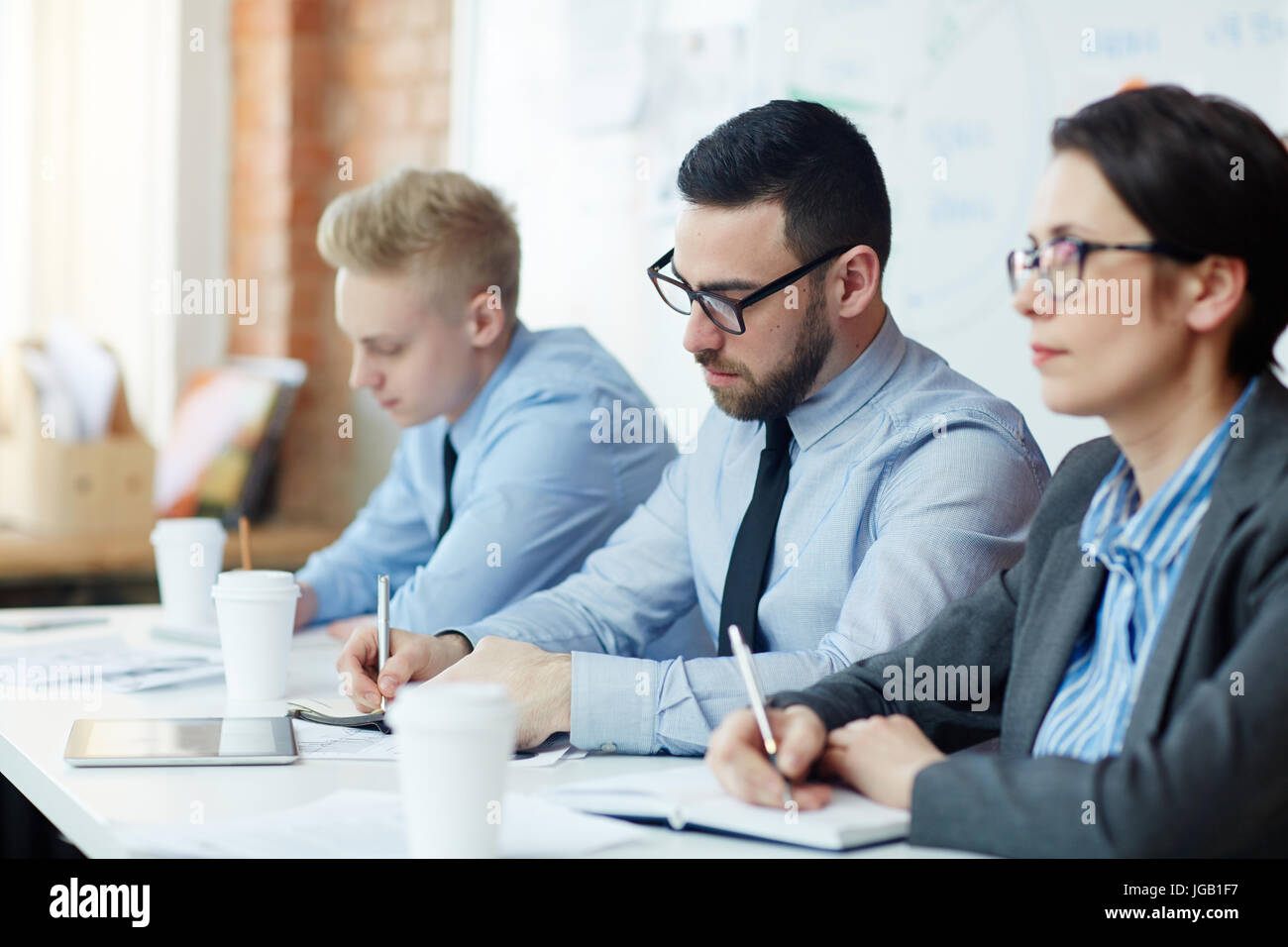 Wrting down ideas - Stock Image