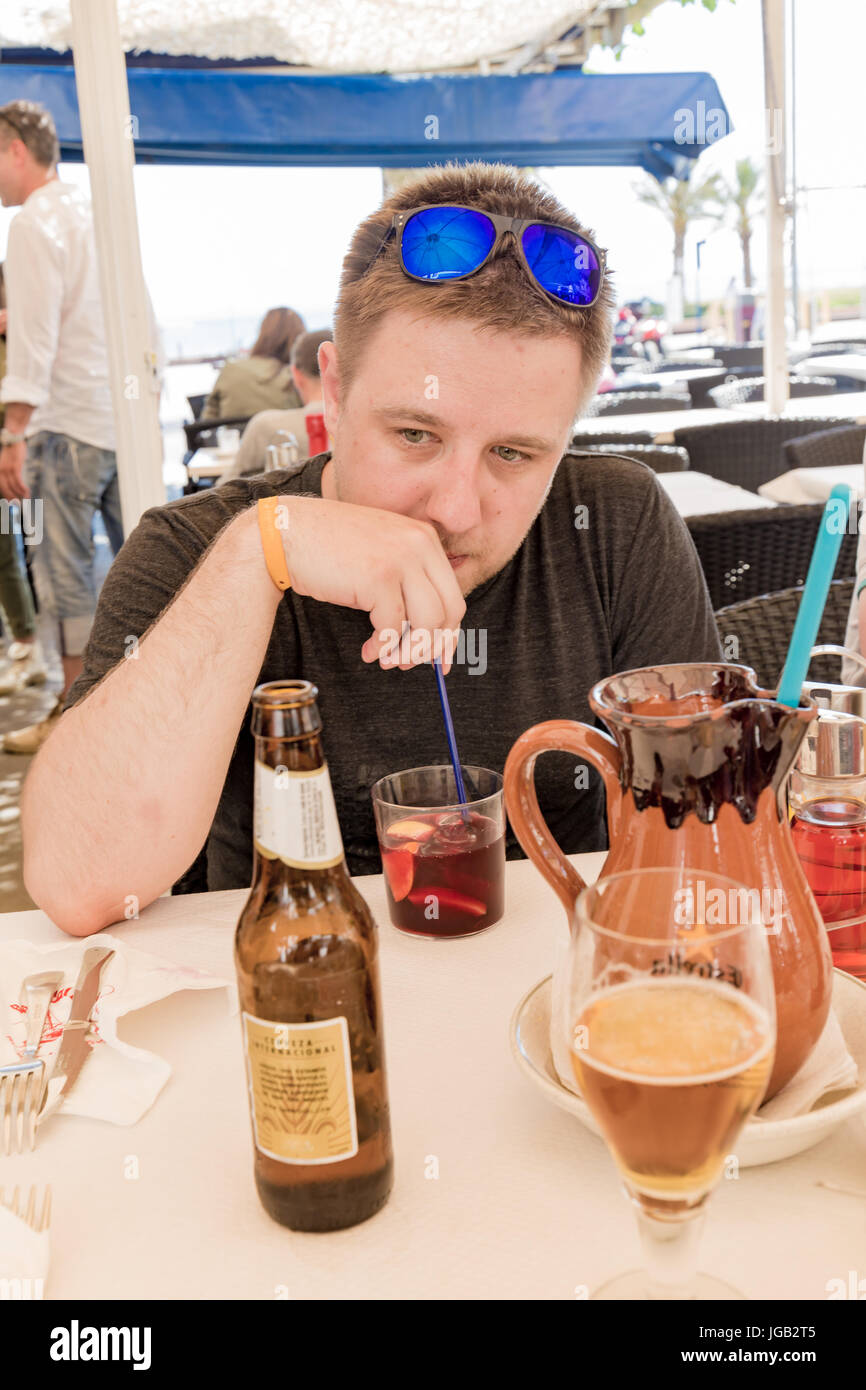 Man drinking sangria and reminiscing - Stock Image