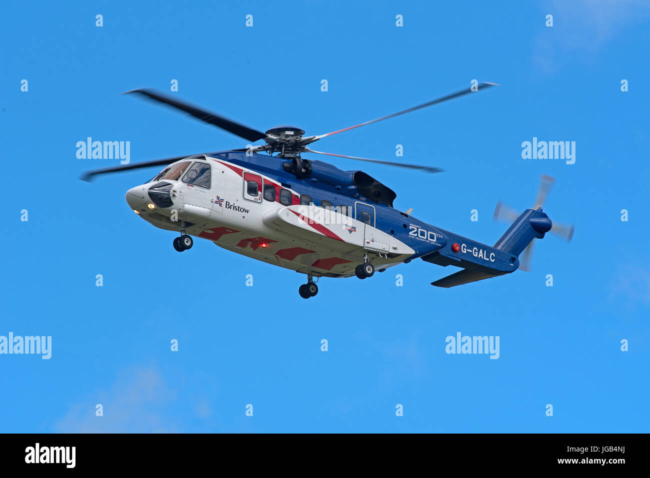 Bristols S92A helicopter on training flight over Inverness airport in Highland Region in the Scottish Highlands. Stock Photo