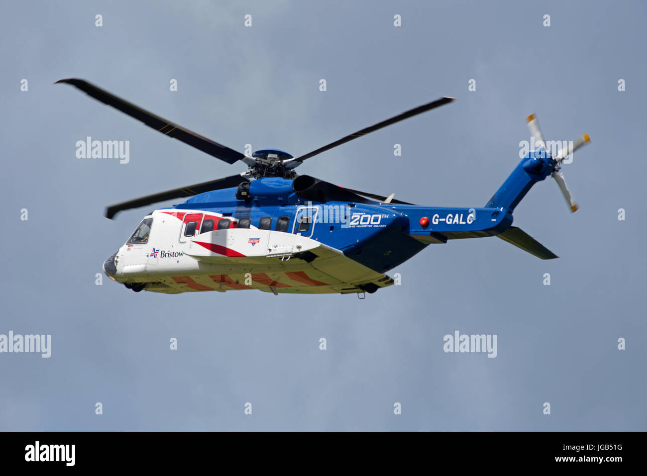 Bristols S92A helicopter on training flight over Inverness airport in Highland Region in the Scottish Highlands. - Stock Image