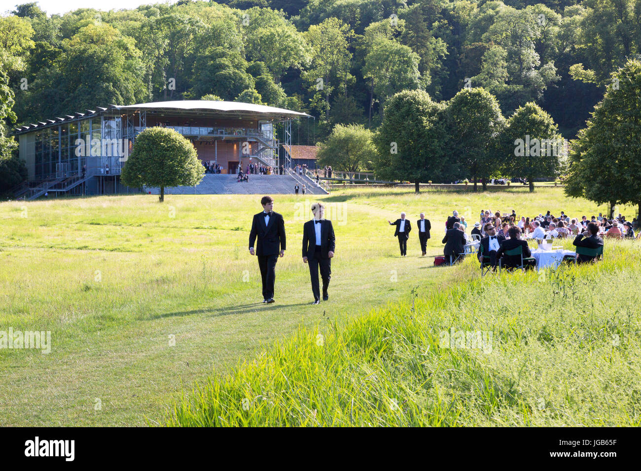 Opera goers at the Opera House, Garsington Opera, Wormsley Park, Stokenchurch, Buckinghamshire England UK - Stock Image