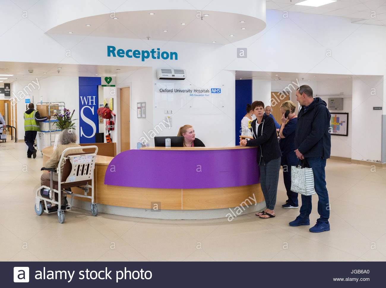 Hospital Reception - patients at the Main Reception desk, John Radcliffe Hospital Oxford England UK - Stock Image