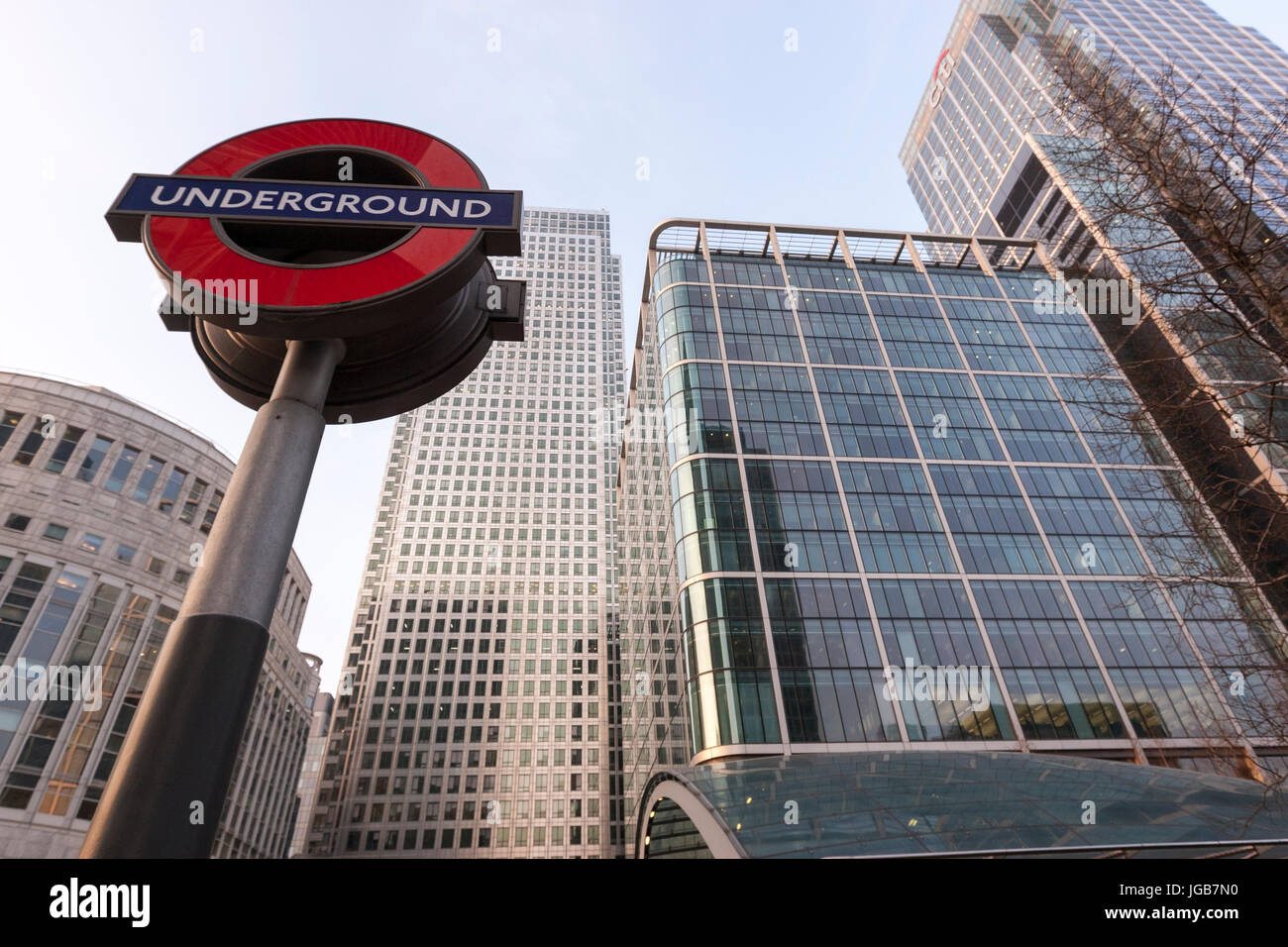 Canary Wharf Underground Station sign at reuters plaza and One Canada Square Tower, Canary Wharf, business district, Stock Photo