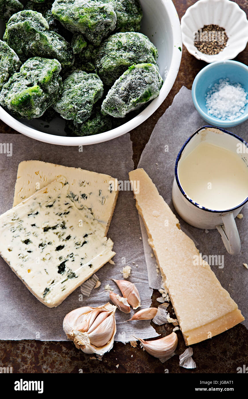 Italian spinach pasta bake ingredients - frozen spinach, cream, parmesan, blue cheese, garlic - Stock Image
