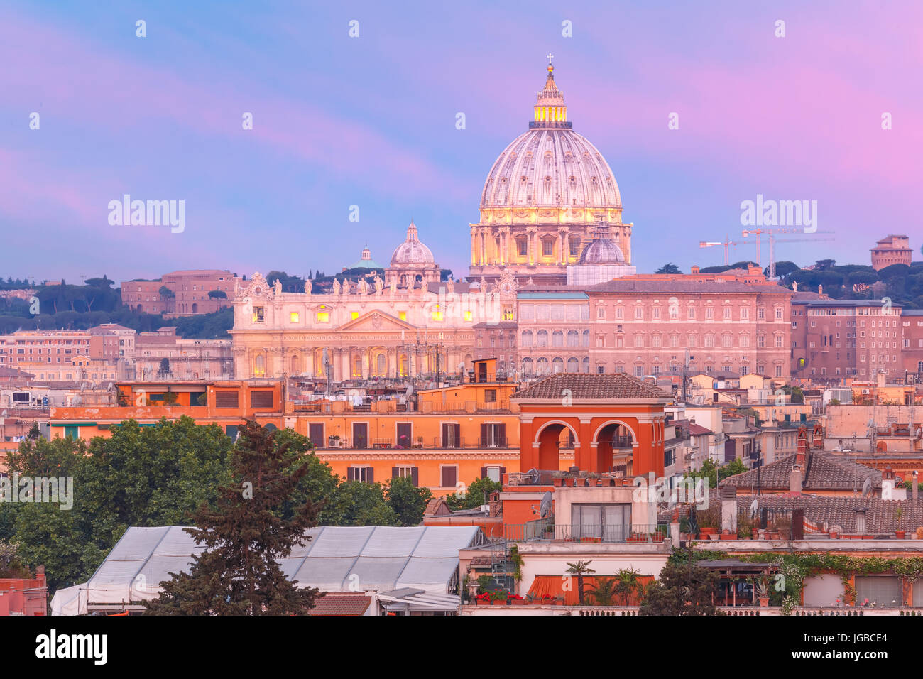 Saint Peter Cathedral at sunset in Rome, Italy. - Stock Image